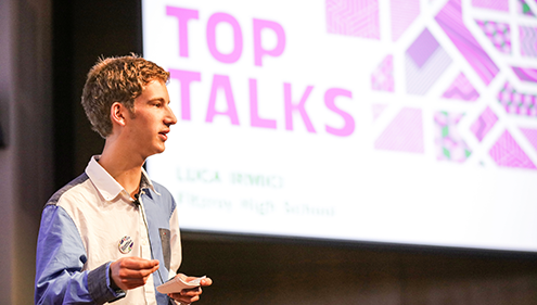 Luca presenting in Top Talks