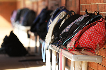 school bags agains a wall